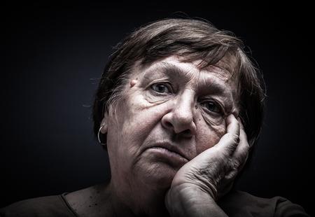 grayness: Portrait of elderly woman. Sorrow. Toned.