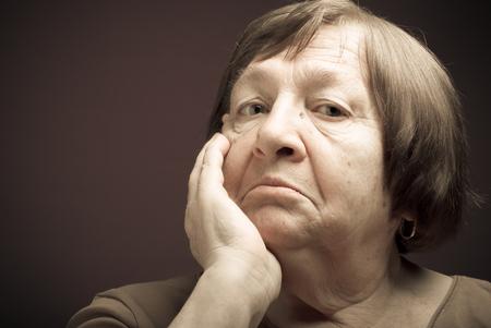Portrait of elderly woman. Perplexity. Toned.