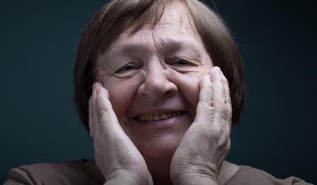 grayness: Portrait of elderly woman. Laugh. Toned.