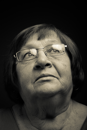 grayness: Portrait of elderly woman. Dreaminess. Toned.