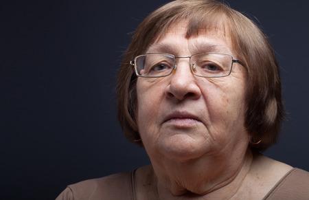 grayness: Portrait of elderly woman. Attention.