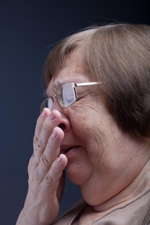 grayness: Portrait of elderly woman. Sneeze.