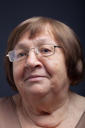 grayness: Portrait of elderly woman. Smile.