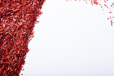 rooibos: Dry rooibos tea leaves as texture for background. Toned. Stock Photo