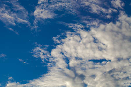 Blue sky with white cumulus clouds. Toned. Stock Photo