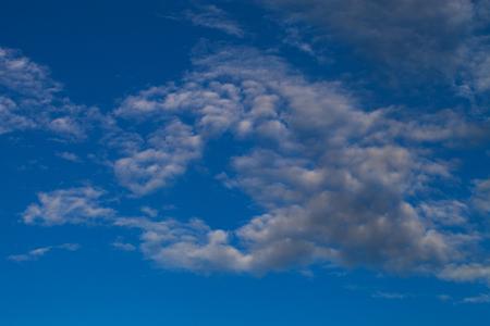 Blue sky with white cumulus clouds.