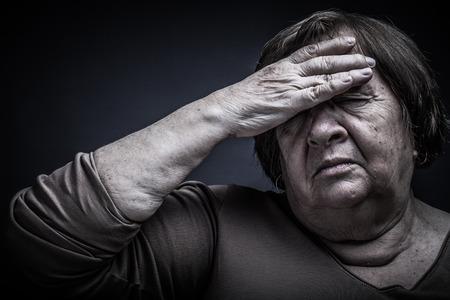 grayness: Portrait of elderly woman. Pain. Toned.