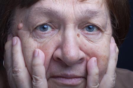 grayness: Portrait of elderly woman. Anxiety. Stock Photo