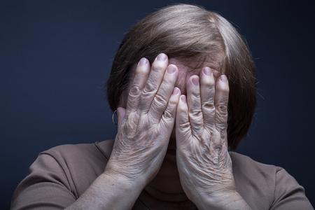 grayness: Portrait of elderly woman. Pain.