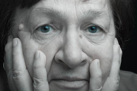 grayness: Portrait of elderly woman. Anxiety. Toned. Stock Photo