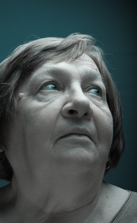 grayness: Portrait of elderly woman. Dream. Toned.
