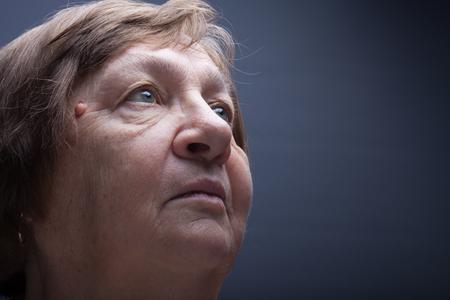 grayness: Portrait of elderly woman. Dream. Stock Photo