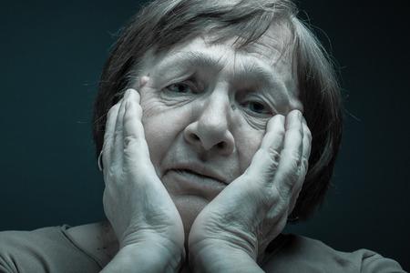 grayness: Portrait of elderly woman. Sad. Toned.