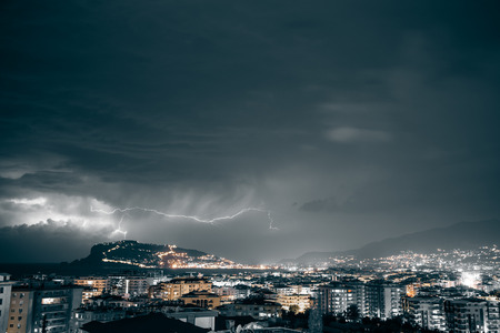 thundershower: Thunderstorm over Alanya main peninsula. Toned.