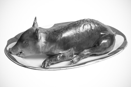 Roast suckling pig in the old porcelain dish. Toned. Stock Photo