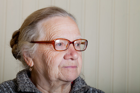 Portrait of elderly woman with glasses.