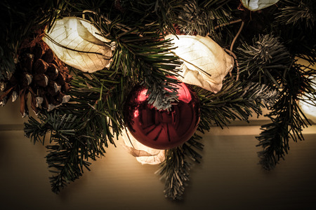 Decorative lights and fir tree branch - christmas decoration. New year and christmas theme. Selective focus. Shallow depth of field. Toned.