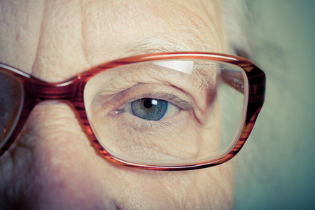 grayness: Portrait of elderly woman with glasses. Toned. Stock Photo