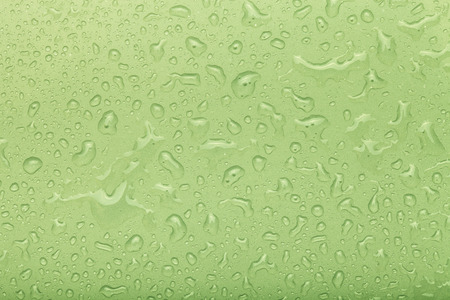 refreshed: Drops of water on a color background. Green. Selective focus. Shallow depth of field. Toned. Stock Photo