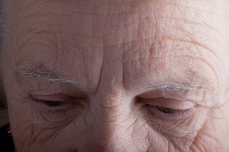 grayness: Portrait of elderly woman. Sad. Closeup. Toned.