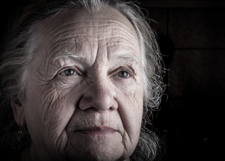 grayness: Portrait of elderly woman. Sad. Toned.
