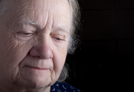grayness: Portrait of elderly woman. Sad.