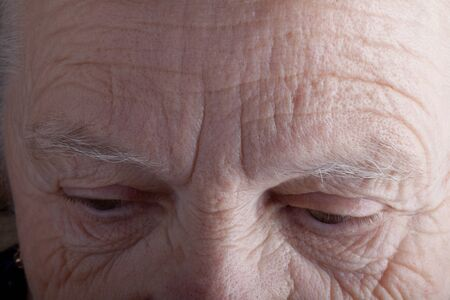 grayness: Portrait of elderly woman. Sad. Closeup.