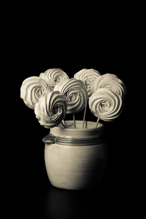 kiss biscuits: Blue round merengue on a stick. Toned. Stock Photo