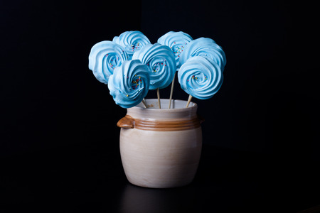 kiss biscuits: Blue round merengue on a stick.