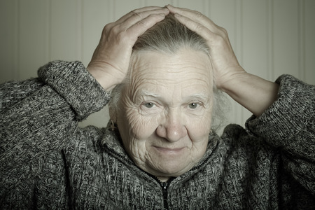 grayness: Portrait of an elderly woman. Toned.