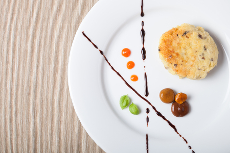 Potato cutlet serving by strokes of different sauces.