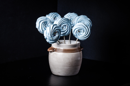 Blue round merengue on a stick. Toned. Stock Photo