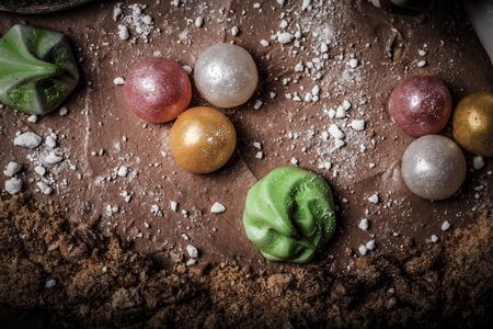 Surface of homemade cake with new year decor. Toned. Stock Photo