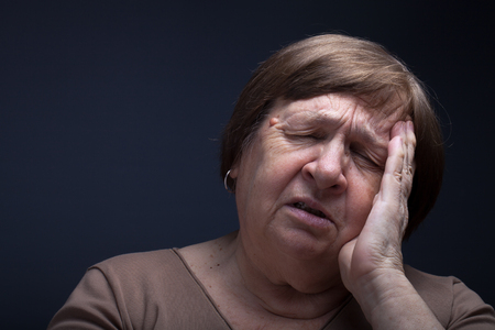 grayness: Portrait of elderly woman. Pain.