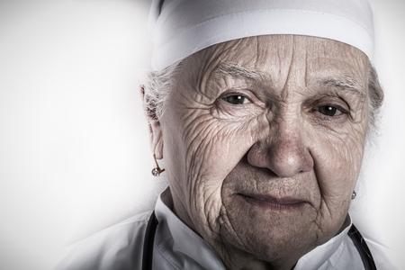 Portrait of senior female doctor. Toned. Stock Photo