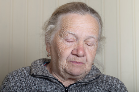 grayness: Portrait of an elderly woman with closed eyes.