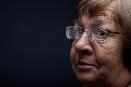 Portrait of elderly woman. Question. Toned. Stock Photo