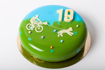 Homemade bright mousse cake with mirror glaze. Bikejoring theme.