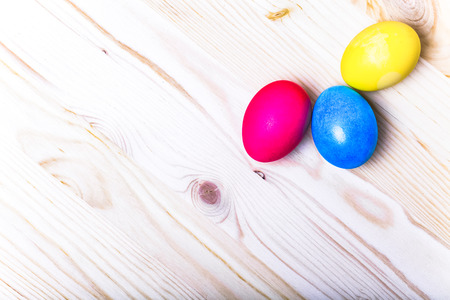 gingerbread: Easter composition on light wooden background. Toned. Stock Photo