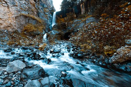 Stormy mountain river in a beautiful autumn landscape in Svaneti. Georgia. Toned. Stock Photo