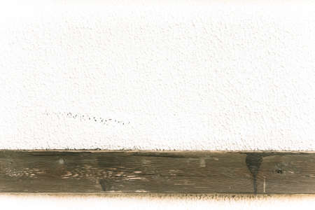 parget: Light plastered wall with wooden stripes for background. Close up detail. Toned.