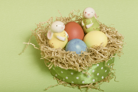 gingerbread: Easter symbols - colored eggs and bunny on light background. Toned.