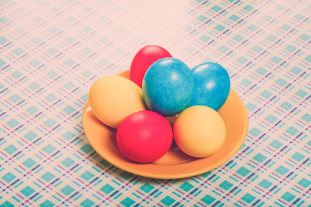 gingerbread: Easter symbols - colored eggs on light background. Toned.