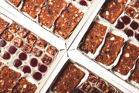 Set of different kinds of natural desserts in a carton box. Toned.