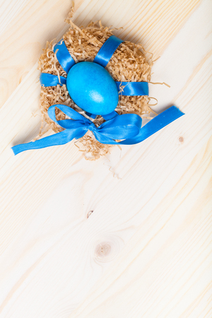 gingerbread: Easter composition on light wooden background. Stock Photo