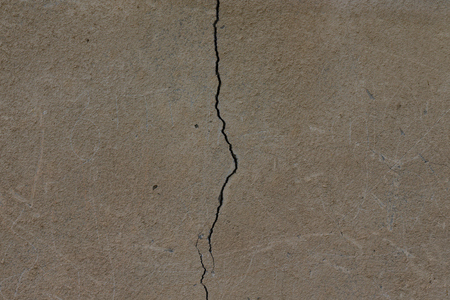 parget: Light plastered wall with crack for background. Close up detail.