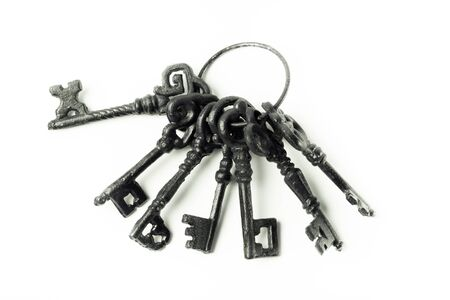 Bunch of old keys on a light background. Toned. Stock Photo