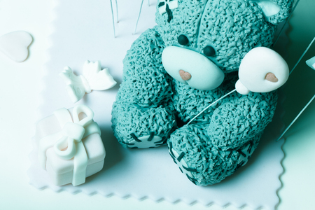 kiss biscuits: Fragment of cake with mastic for childrens birthday. Toned. Stock Photo