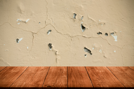 torn: Light plastered wall with crack. Background. View from dark wooden gangway, table or bridge. Collage. Toned.