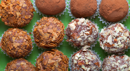 Set of different kinds of homemade chocolate truffles.